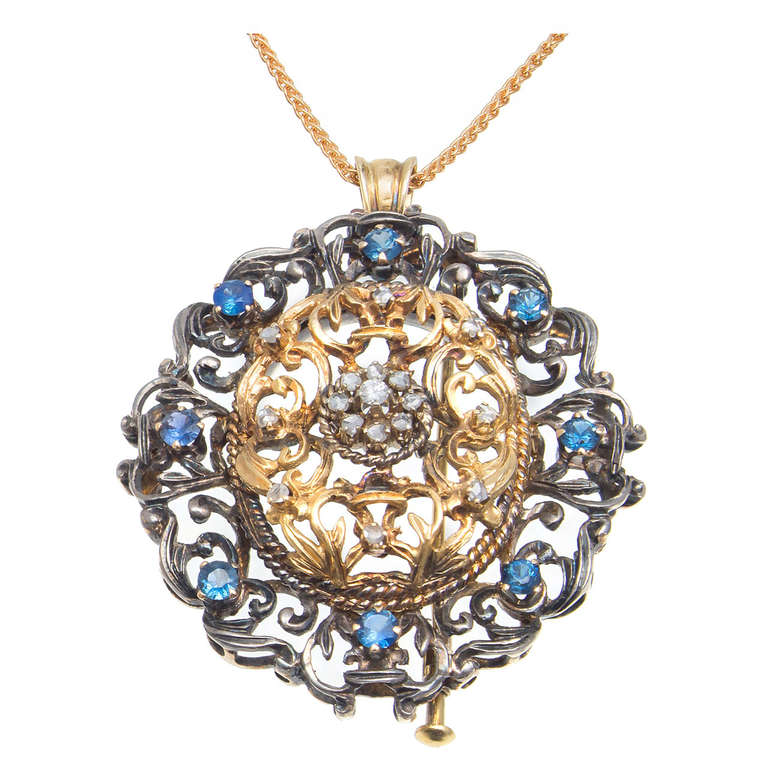 1920s Victorian Revival Sapphire Diamond Silver Gold Brooch Pendant For Sale