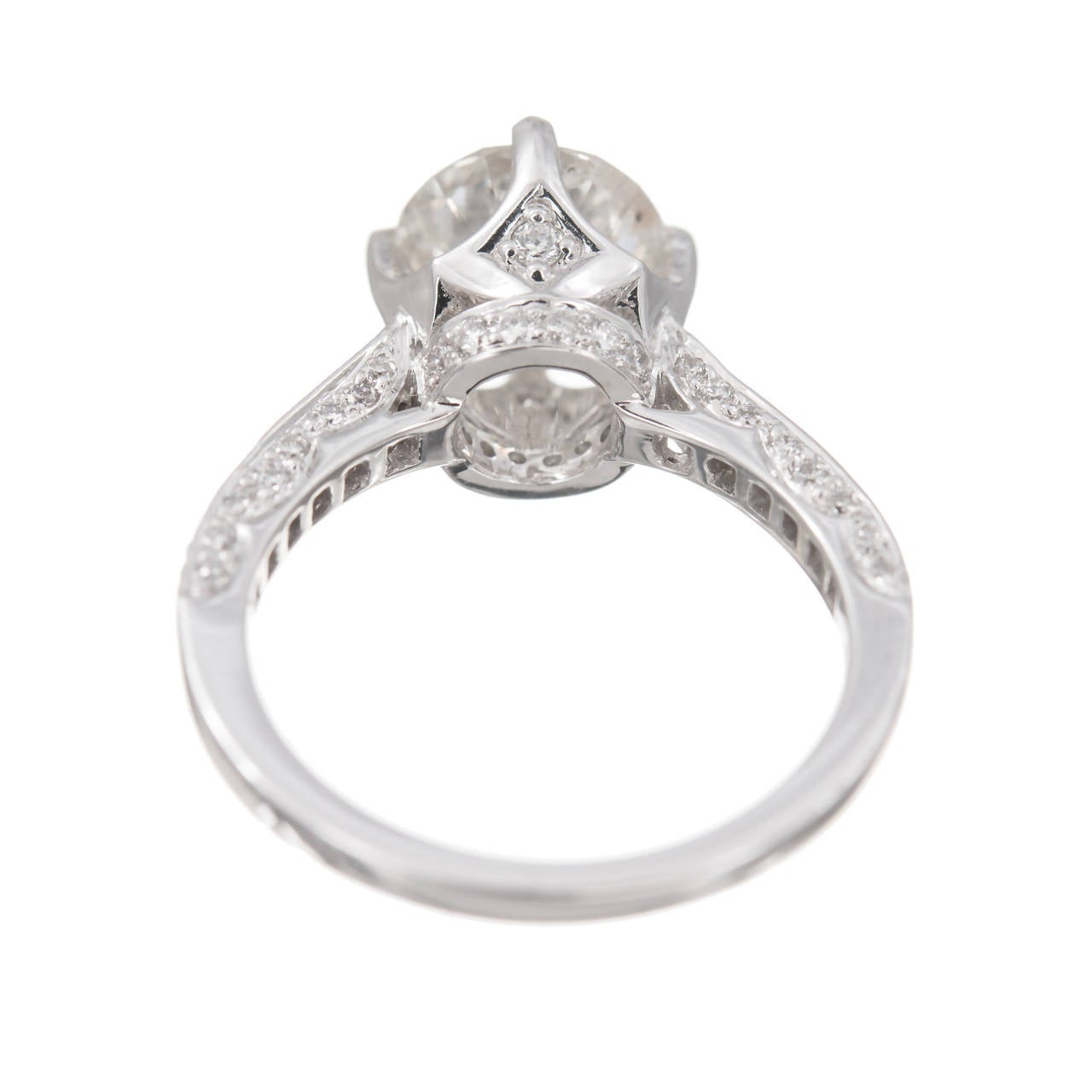 Round diamond solitaire engagement ring. Sparkly transitional Ideal cut center diamond faces up white and sparkly. 18k white gold setting with accent diamonds.Circa 1960.  1 round brilliant transitional  cut diamond, approx. total weight 2.51cts,