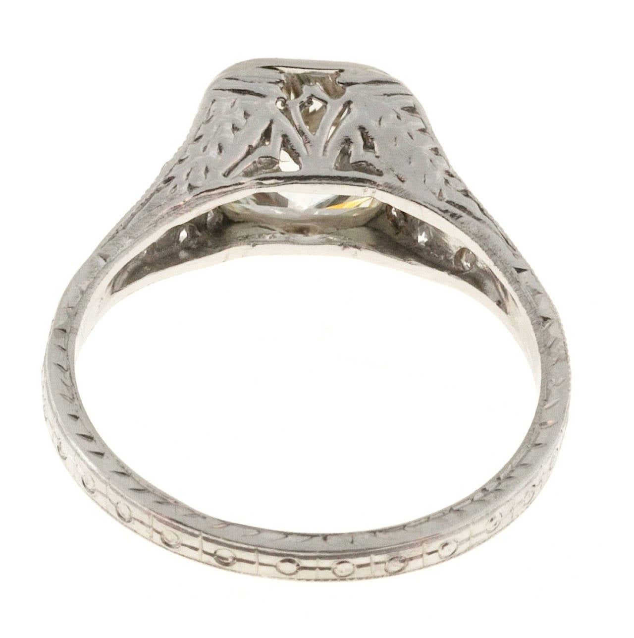 One of the most beautiful 1920's original Platinum ring I have seen in years. Hand engraving and filigree with a world class antique cushion cut super sparkly diamond with raised crown and small table.