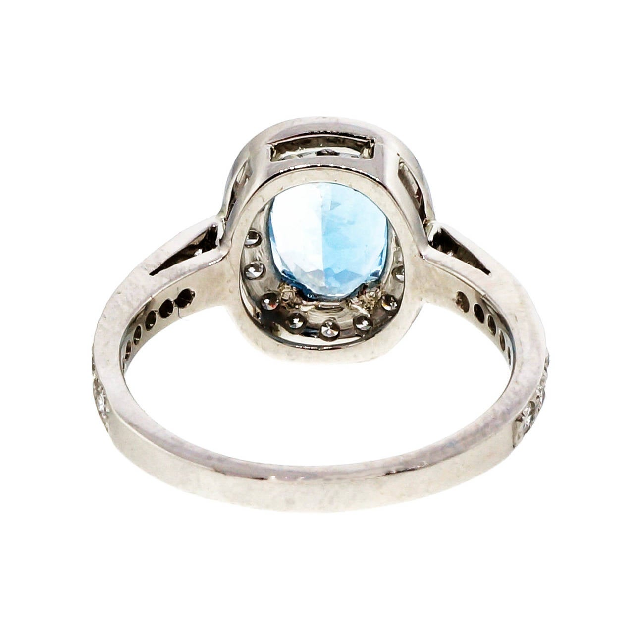 Well made solid Platinum Halo style ring with Ideal F, VS diamonds and a bright sparkly untreated Aqua. Extra fine high grade quality. Circa 1980.