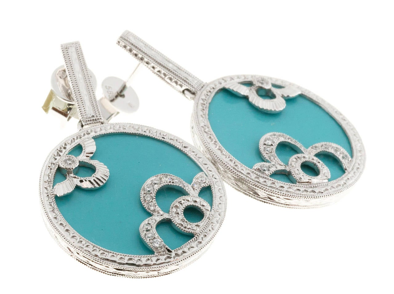 Hand detailed and engraved bead set dangle earrings with good diamond accents and fine Robins egg Turquoise centers.