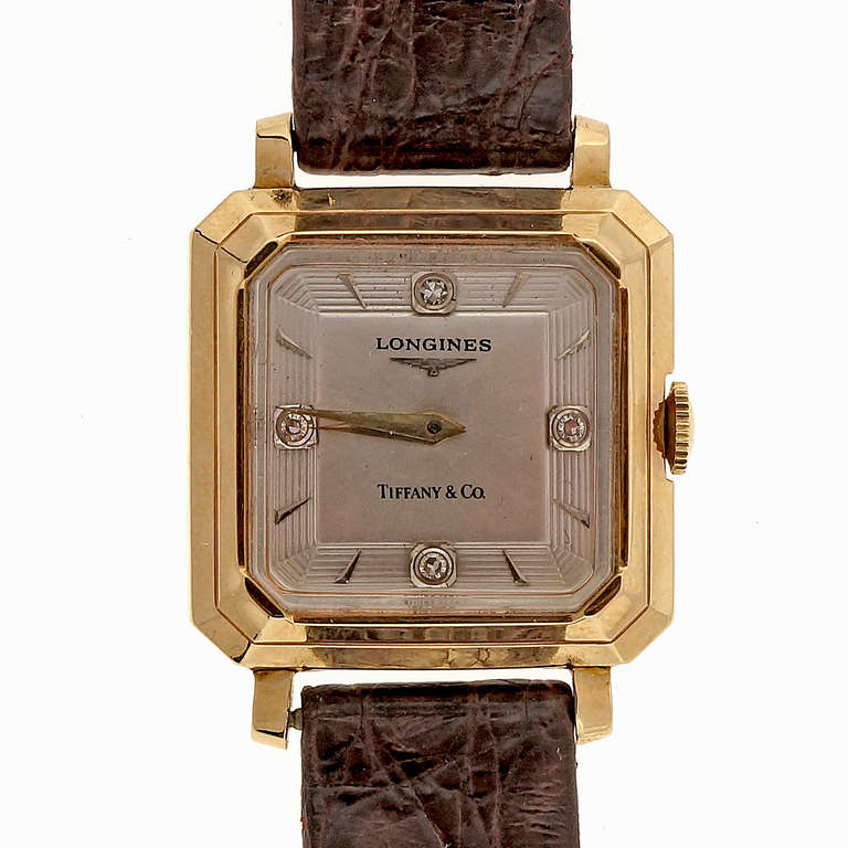 Longines 14k yellow gold wristwatch with diamond dial, retailed by Tiffany & Co., circa 1950s. Octagonal case.  Width without crown: 27.82mm Width with crown: 28.88mm Band width at case: 16mm  Case thickness: 8.38mm Outside case: 14k Inside