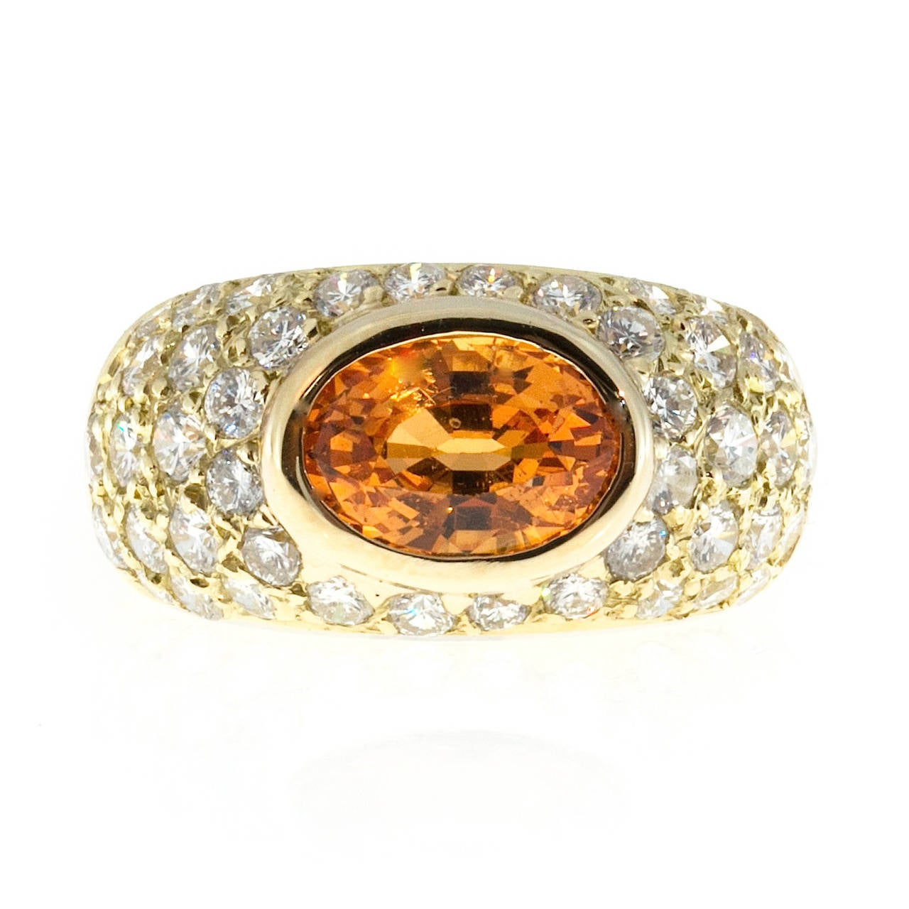 Extra bright and sparkly genuine Spessartite Garnet set sideways in a handmade 1960-1970 dome ring pave set with fine Ideal colorless diamonds. The stone looks bottomless as you stare into it.