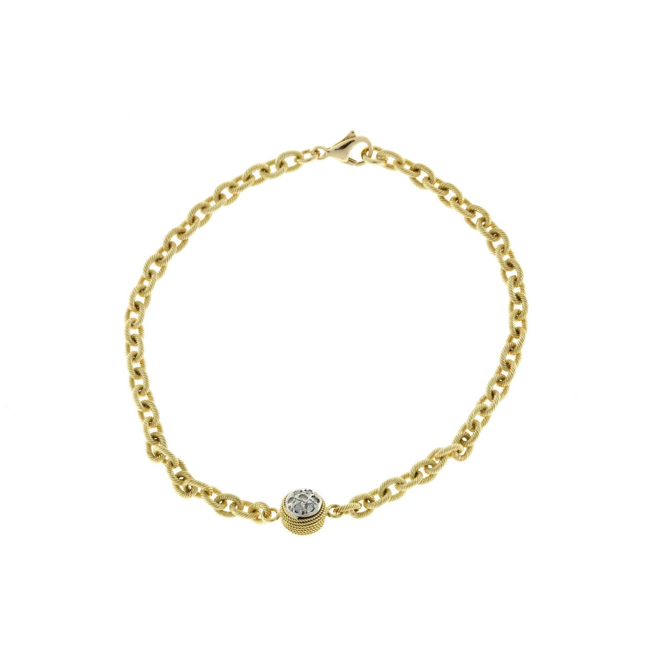 Beautiful two sided 18k yellow gold textured bracelet with diamond ball center.