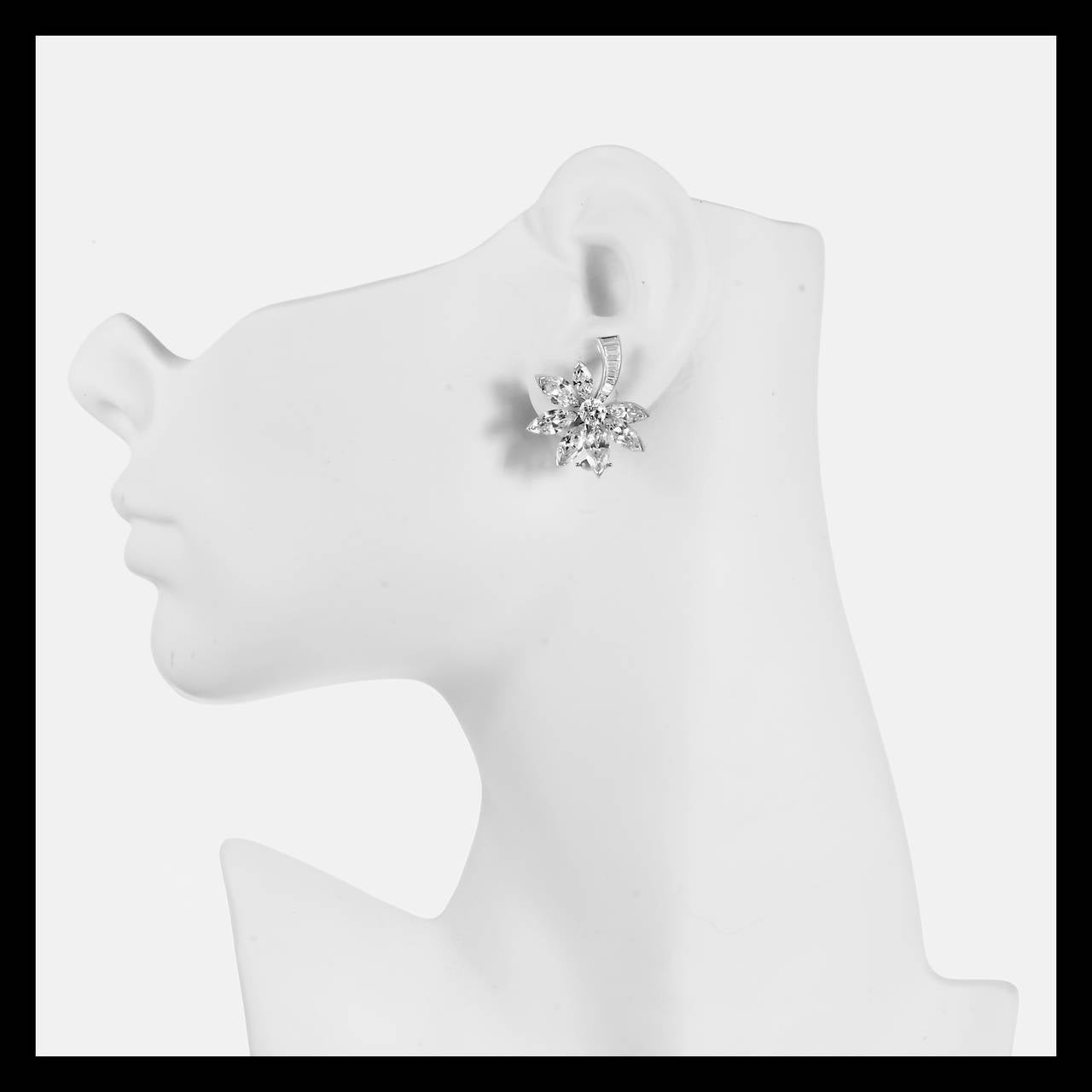Dramatic and distinctive Fireworks or Comet design handmade Platinum earrings with extra sparkly well cut diamonds in solid Platinum with 14k white gold Omega clip backs and posts. The baguette section goes up and the Marquise point down. An