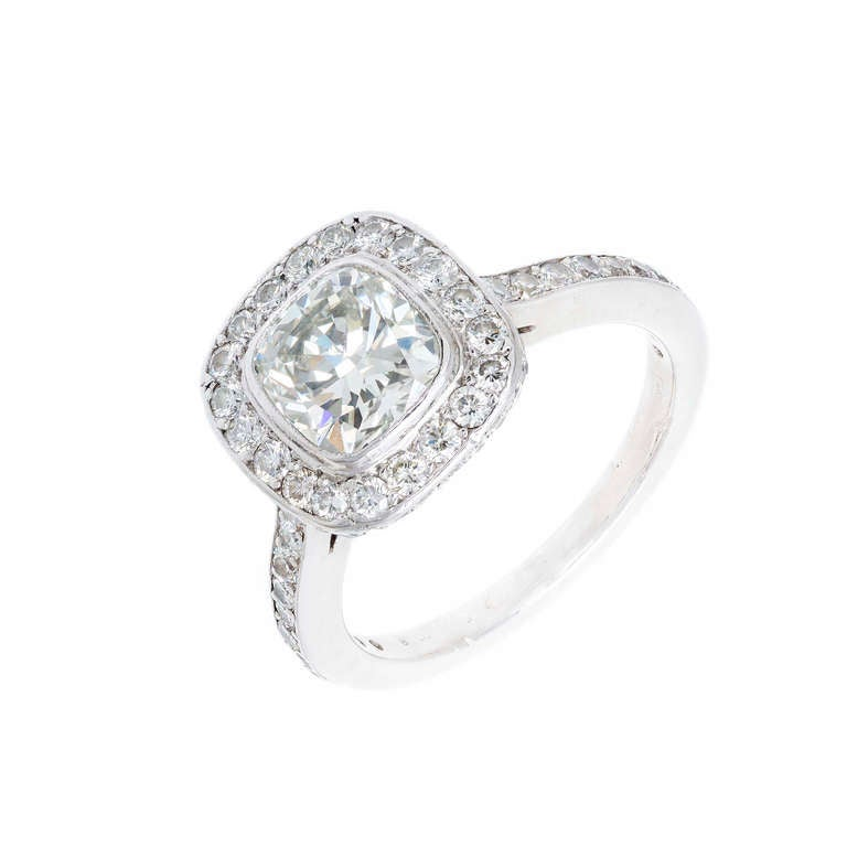 Beautiful Halo design classic cushion top ring with a beautifully cut cushion center diamond 1.51ct, F, VS2 Ideal cut with excellent sparkle. Depth: 67.8%  Table: 68%. Excellent condition, no repairs or defects. Looks great on the hand. Platinum