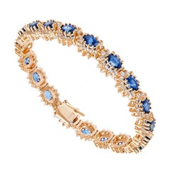 GIA Certified 15.50 Carat Oval Sapphire Round Diamond Yellow Gold Bracelet