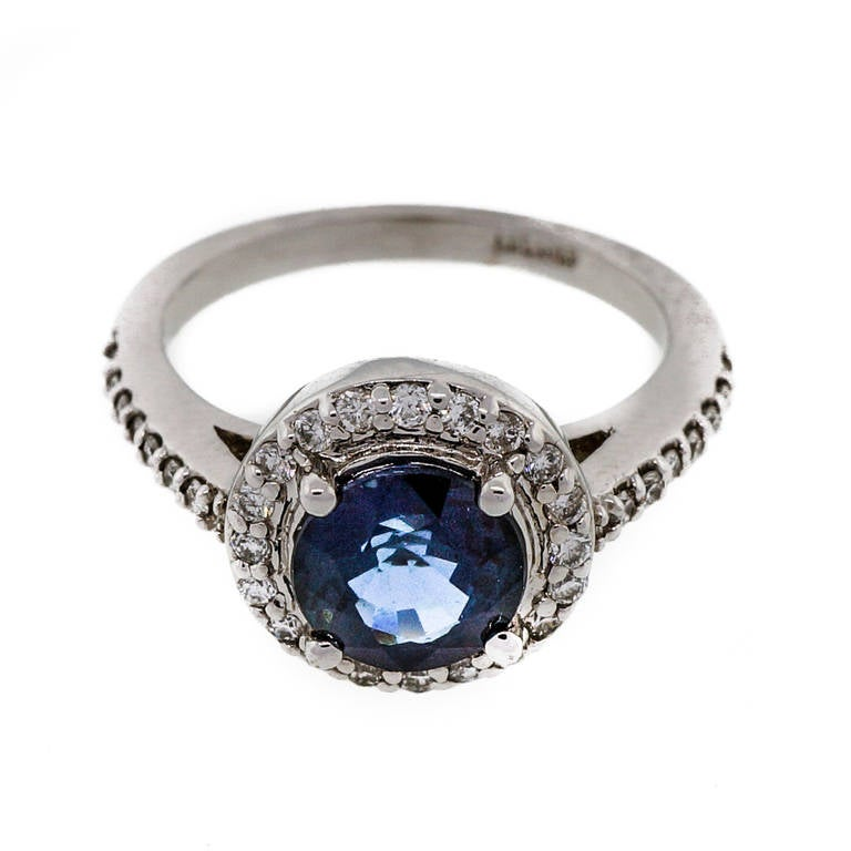 royal blue sapphire white gold halo engagement