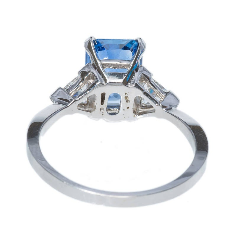 emerald cut sapphire white gold engagement ring at