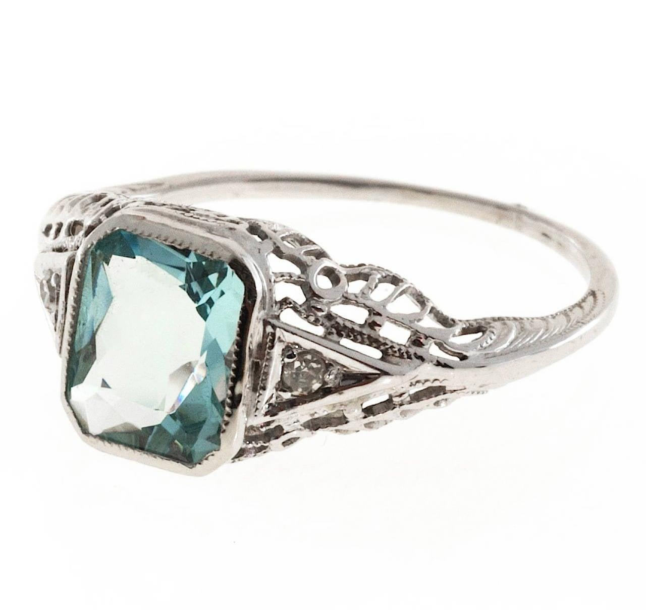 Art Deco filigree ring  cut natural untreated Aqua. Circa 1930 to 1940.  1 Natural no heat untreated Aqua, approx. total weight 1.58cts, 8 x 6.5mm 2 single cut diamonds, approx. total weight .02cts, I, VS2 14k White Gold 2.0 grams Width at