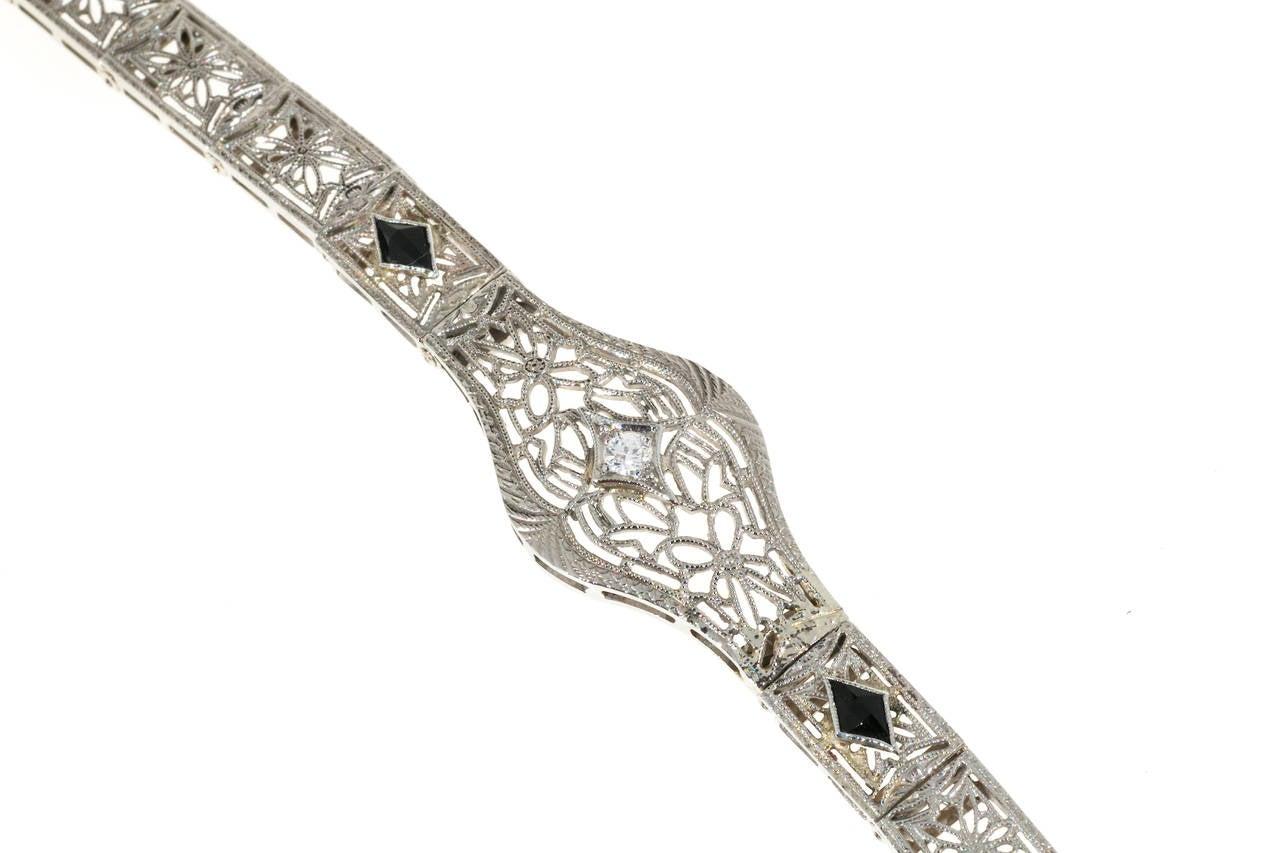 Round Cut Diamond Calibre Sapphire White Gold Filigree Bracelet For Sale