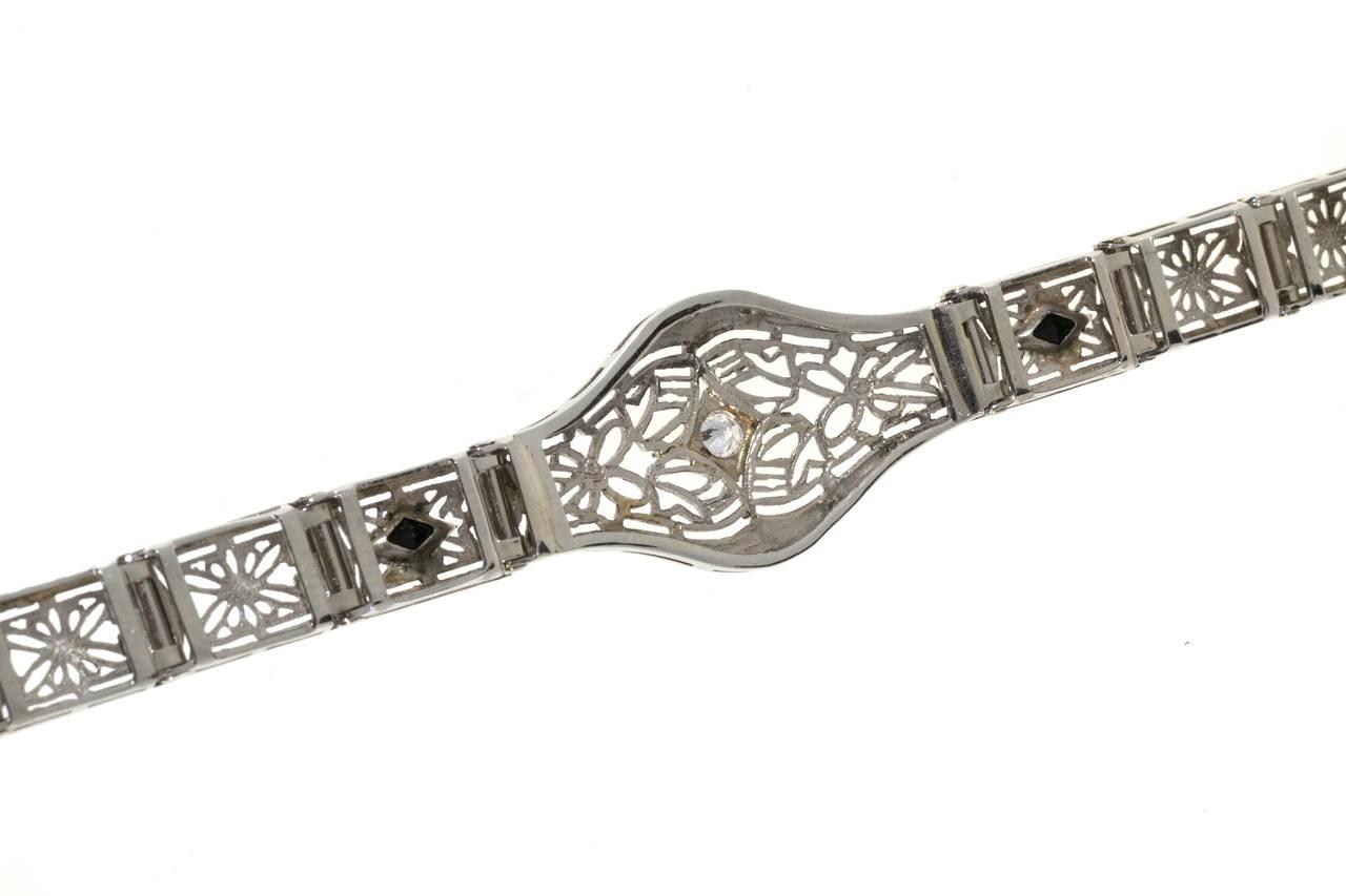 Women's Diamond Calibre Sapphire White Gold Filigree Bracelet For Sale