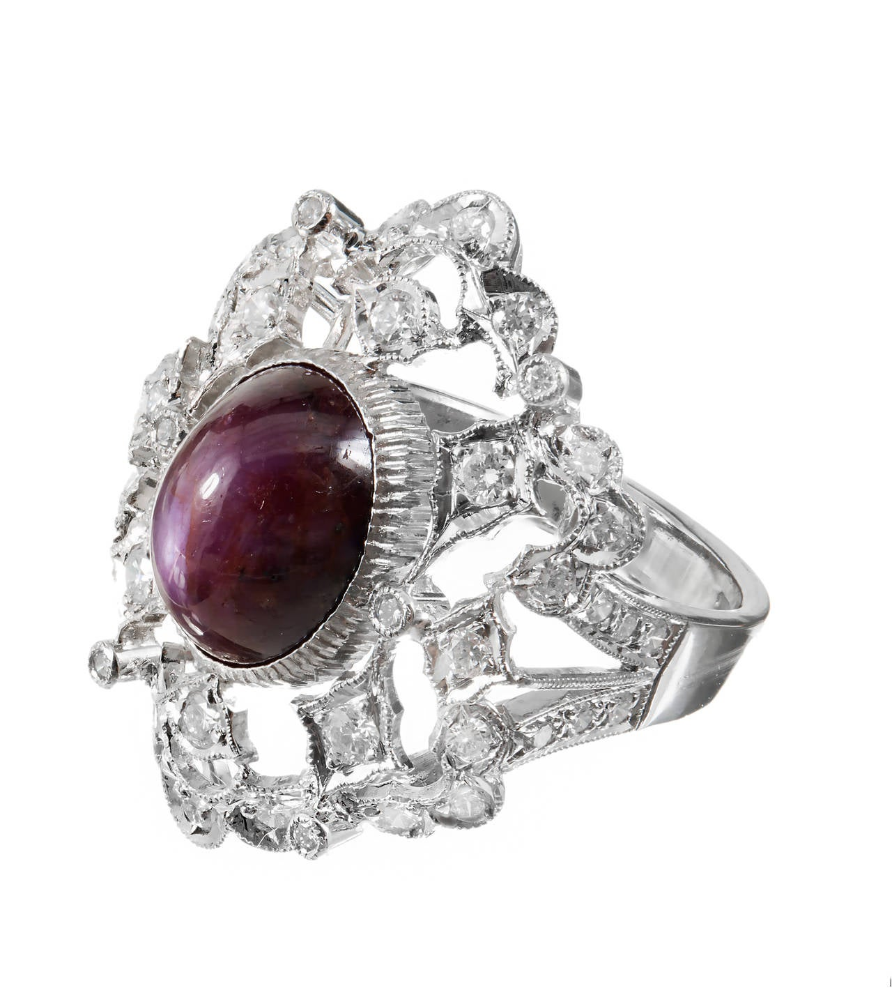 Rare natural certified no heat purplish red star Ruby approx. 3.00cts in an 18k white gold estate open work ring. Matches our star Ruby earrings.  1 oval cabochon purplish red star Ruby, approx. total weight 3.00cts, 10.52 x 8.50 x 7.67mm,