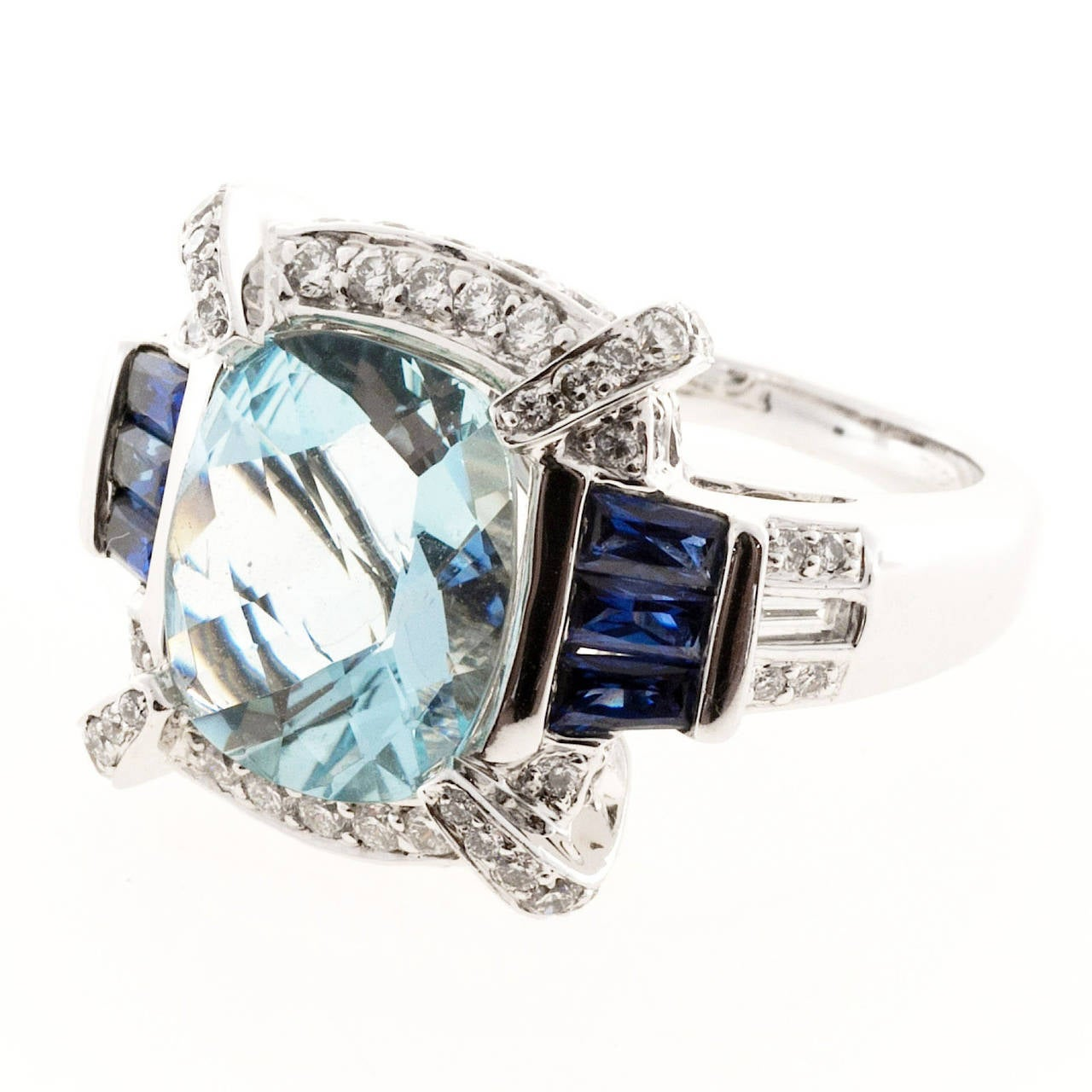 Authentic beautiful Charles Krypell solid 18k white gold ring with a genuine Aqua and fine blue Sapphires and top white full cut diamonds. Charles Krypell is known for bold designs and fine workmanship and stones.  1 cushion Aqua 12.5 x 10mm
