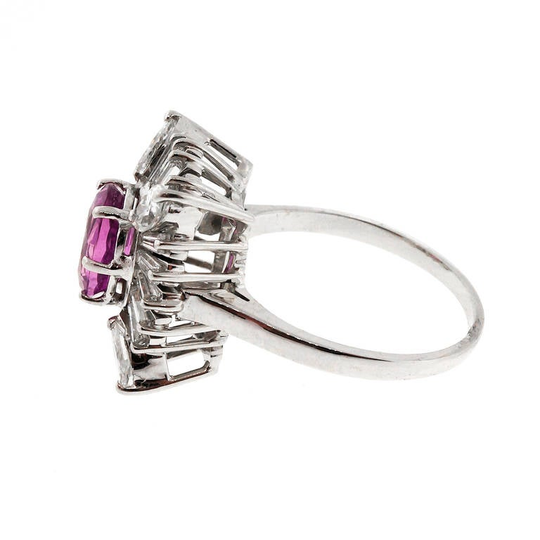 1950's 14k white gold ring with Marquise and tapered baguette diamonds surrounding a pink Sapphire. GIA certified natural corundum, simple heat only, no other enhancements.