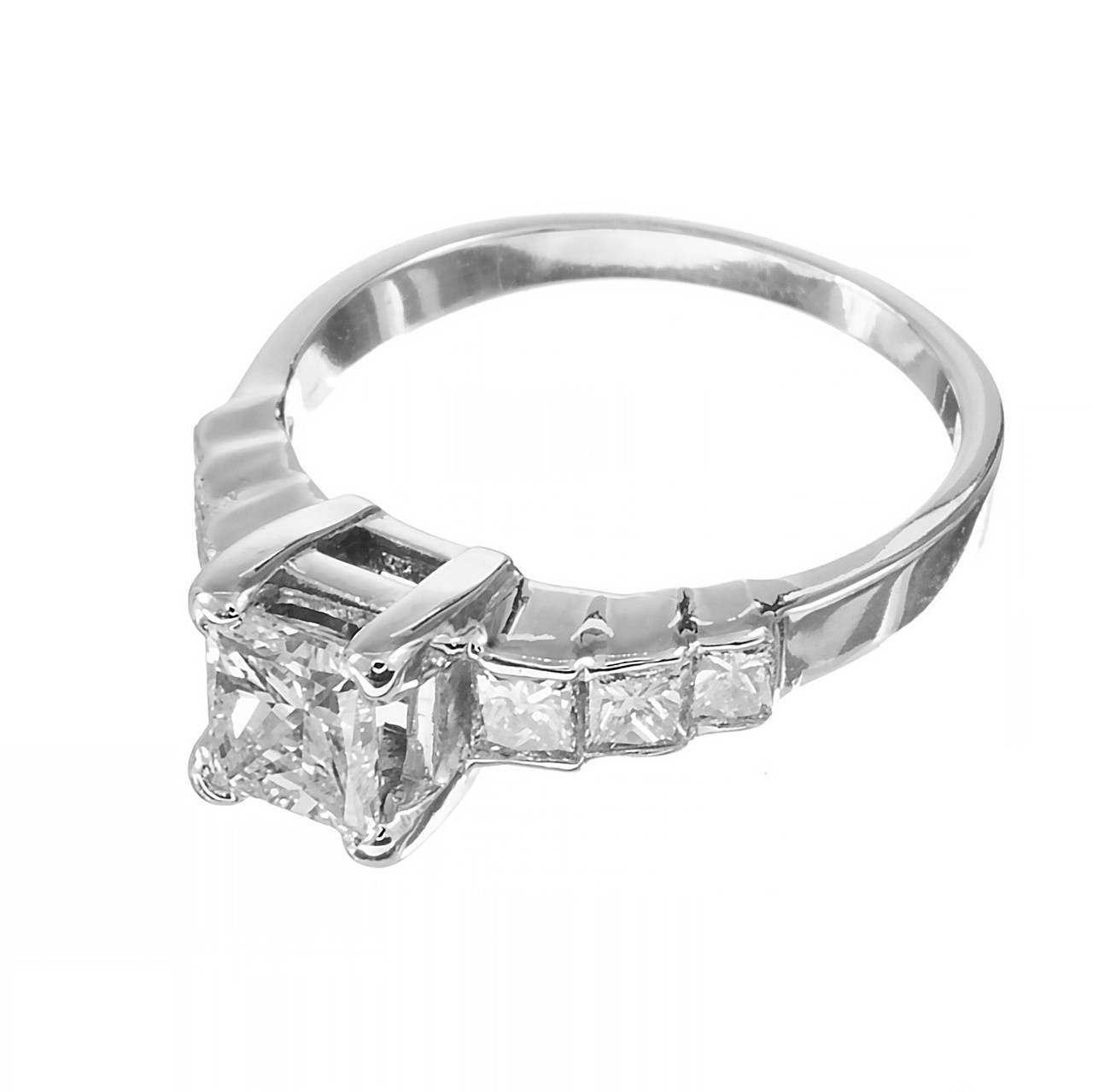 Very nice well designed simple Princess cut diamond engagement ring with graduated Princess cut side diamonds. crt  1 rectangular diamond, approx. total weight .75cts, VS2, 6 square Princess cut diamonds, approx. total weight .45cts, F – G, VS –