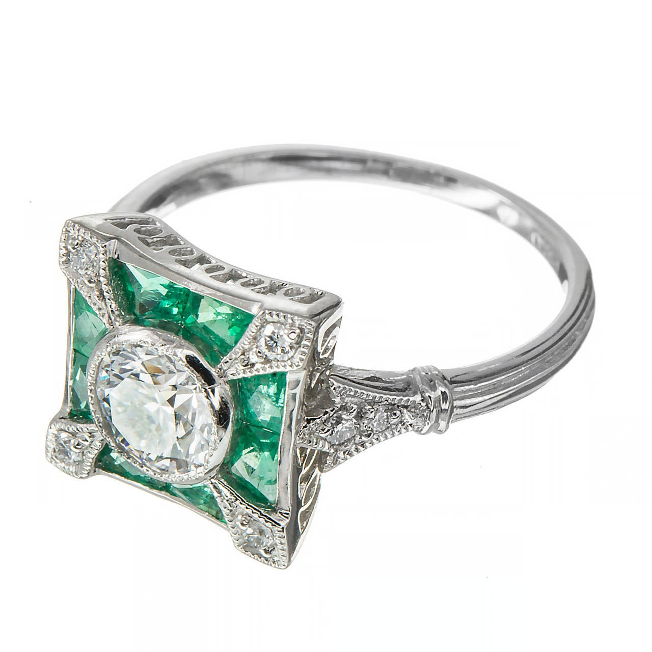 Center diamond GIA certified. Ideal cut 0.65ct. E, VVS1. Platinum ring with calibre cut genuine Emeralds. Center diamond removed for grading and then reset.   1 round diamond, approx. total weight .63cts, E, VVS1, excellent cut, GIA certificate