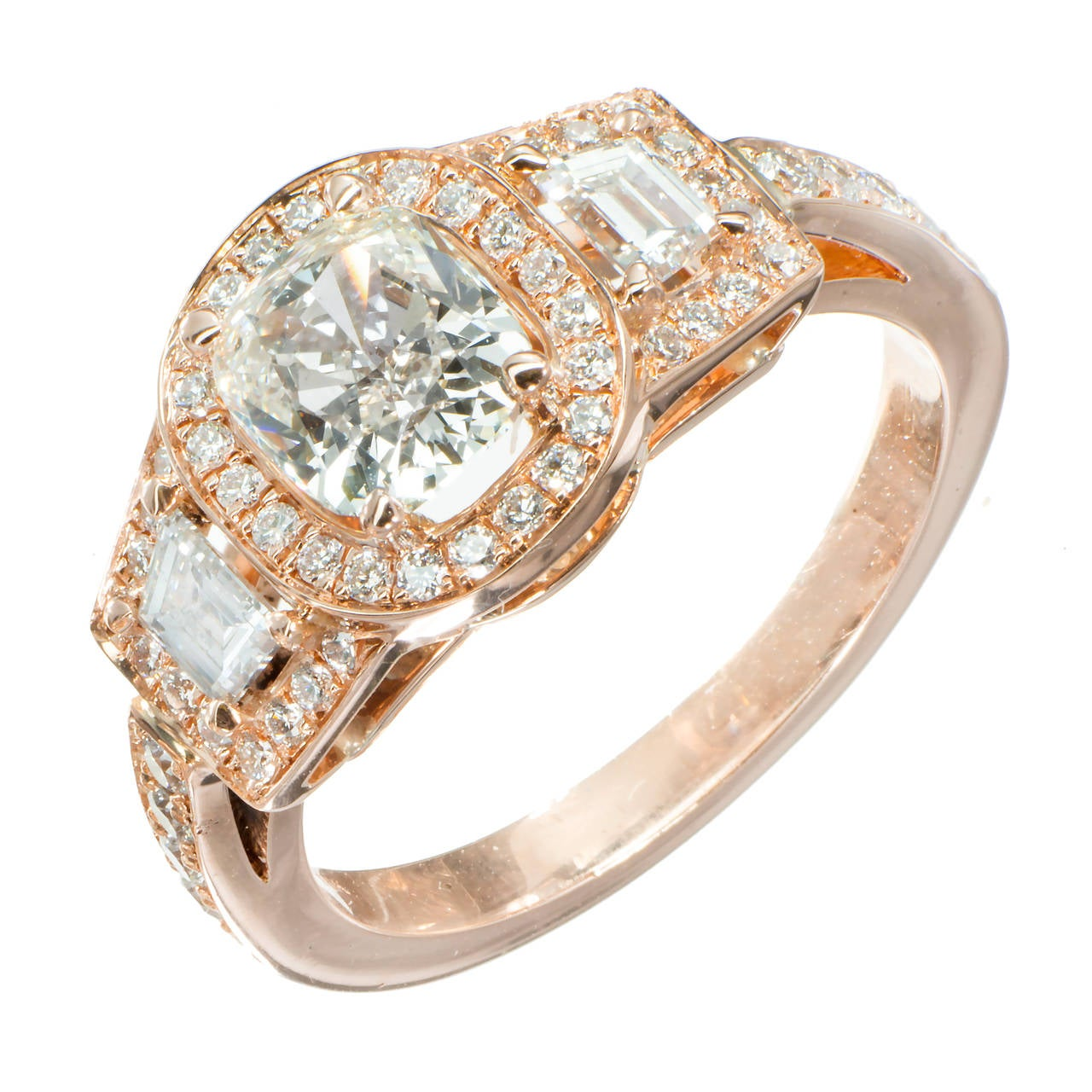 Old cushion cut sparkly three-stone diamond 1.03cts engagement ring. The cushion cut center and 2 trapezoid diamonds are from a 1920's estate. The 18k rose gold round diamond halo setting is from the Peter Suchy Workshop. EGL certified, EGL