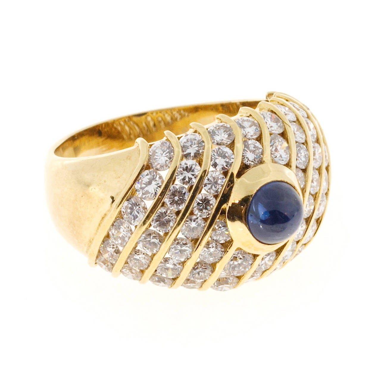 Beautiful wide tapered top quality dome ring with a gem blue Sapphire center and F, VS sparkly diamond sides.  CMT Type 1 natural Sapphire simple heat only, one cabochon gem blue Sapphire, approx. total weight .94cts. GIA certificate