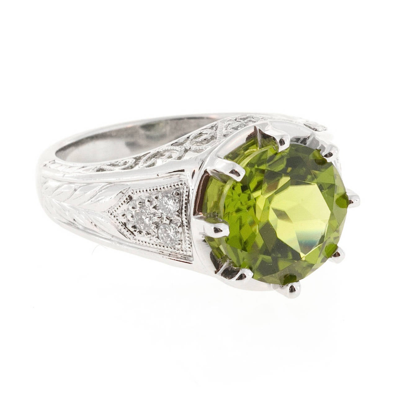 Platinum ring with a top gem round European cut Peridot 4.25ct and nice sparkly diamonds. circa 1940.