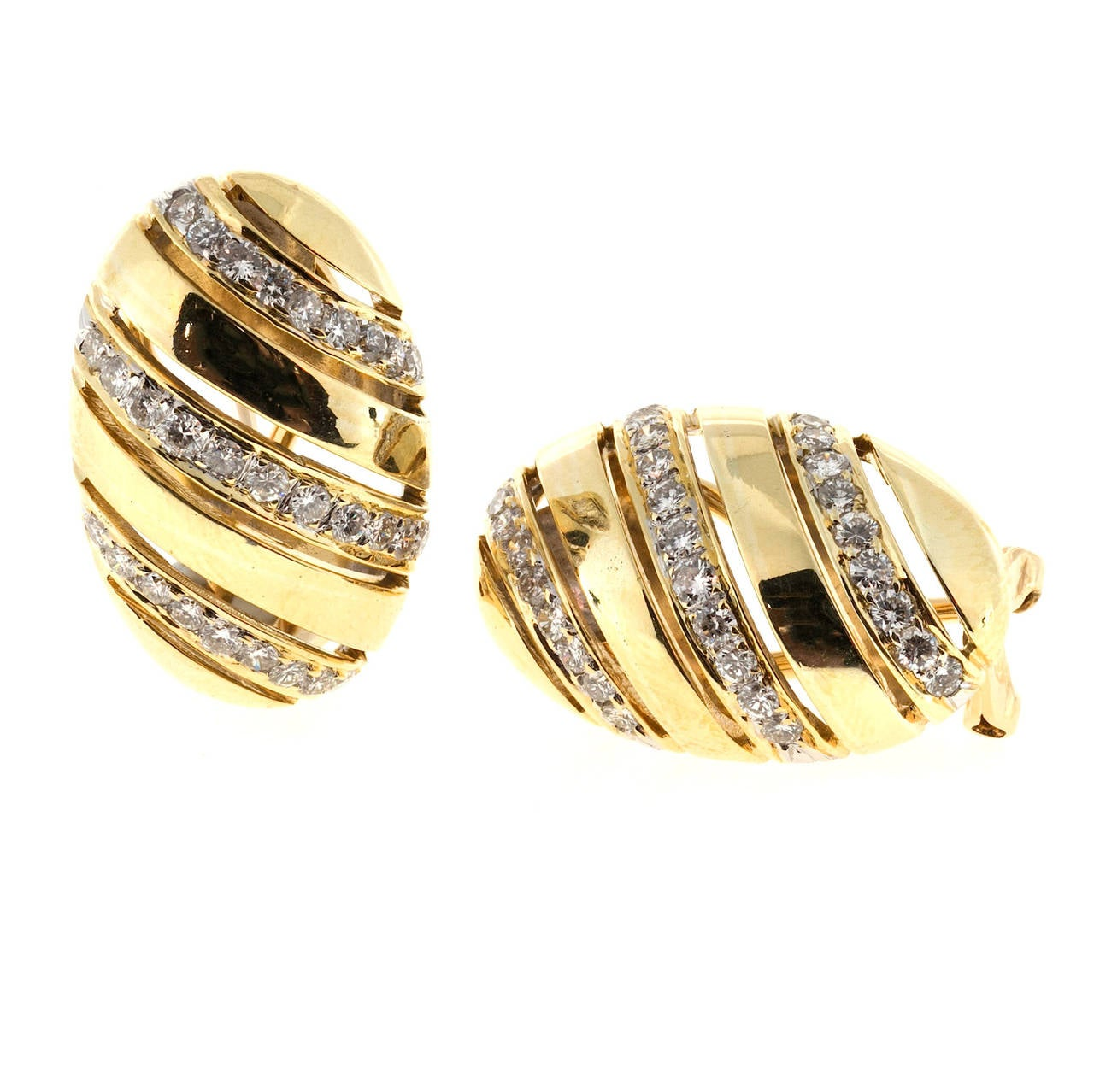 1960's domed oval clip post 18k yellow gold earrings with bright full cut diamonds.  58 round diamonds¸ approx. total weight 1.16cts, G – H, VS2 18k yellow gold 16.1 grams Tested: 18k Stamped: 18k 750 Top to bottom: 23.58mm or .93