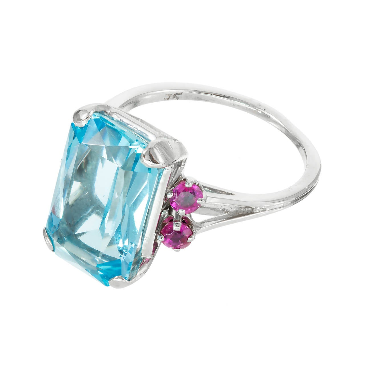 1950  gem blue untreated natural 6.03ct Aqua in a simple white gold ring with bright red Rubies, well-polished. Excellent color combinations.