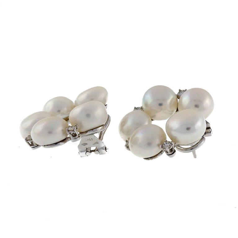 Bold and stylish circular clip post fresh water pearl and fine diamond 18k white gold diamond earrings.