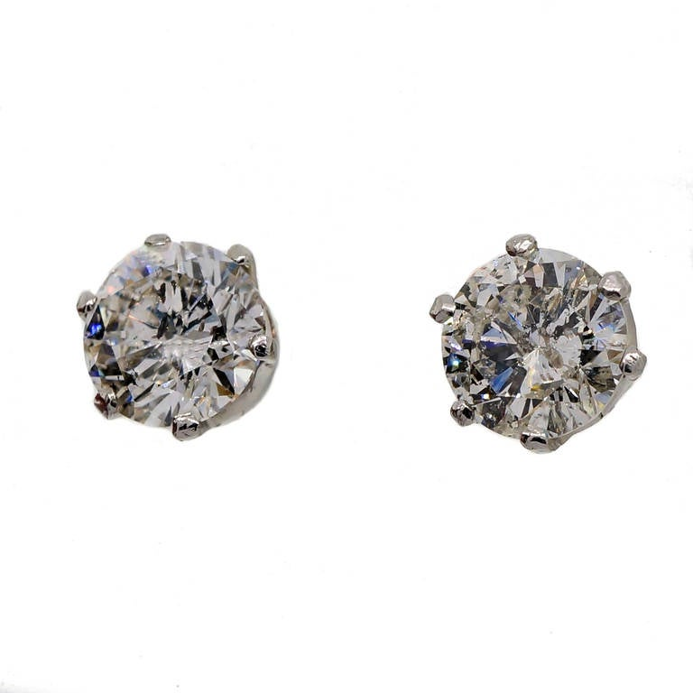 1930 transitional cut diamond stud earrings bright and sparkly in handmade crown style settings with a yellow base and white top. Later La Pousette style pierced post safety backs.