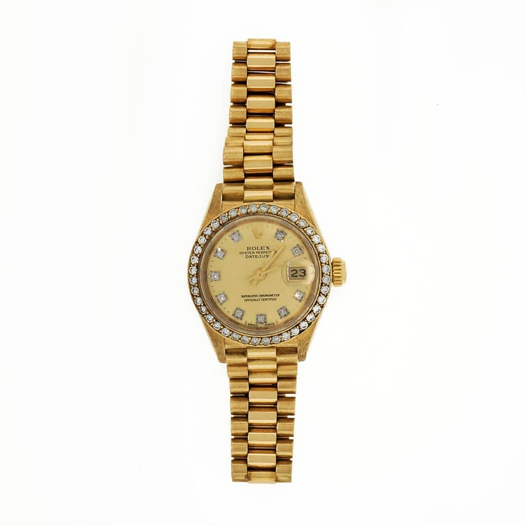 Rolex Lady's 18k Yellow Gold and Diamond Datejust Wristwatch Ref 69138, with gilt diamond dial, circa 1985.  18k yellow gold Length: 6.75 inches Length: 32.87mm Width: 26mm Bracelet width at case: 13mm Case thickness: 10.5mm Bracelet: 8570F