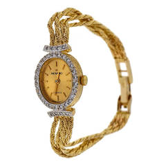 Movado Lady's Yellow Gold and Diamond Wristwatch