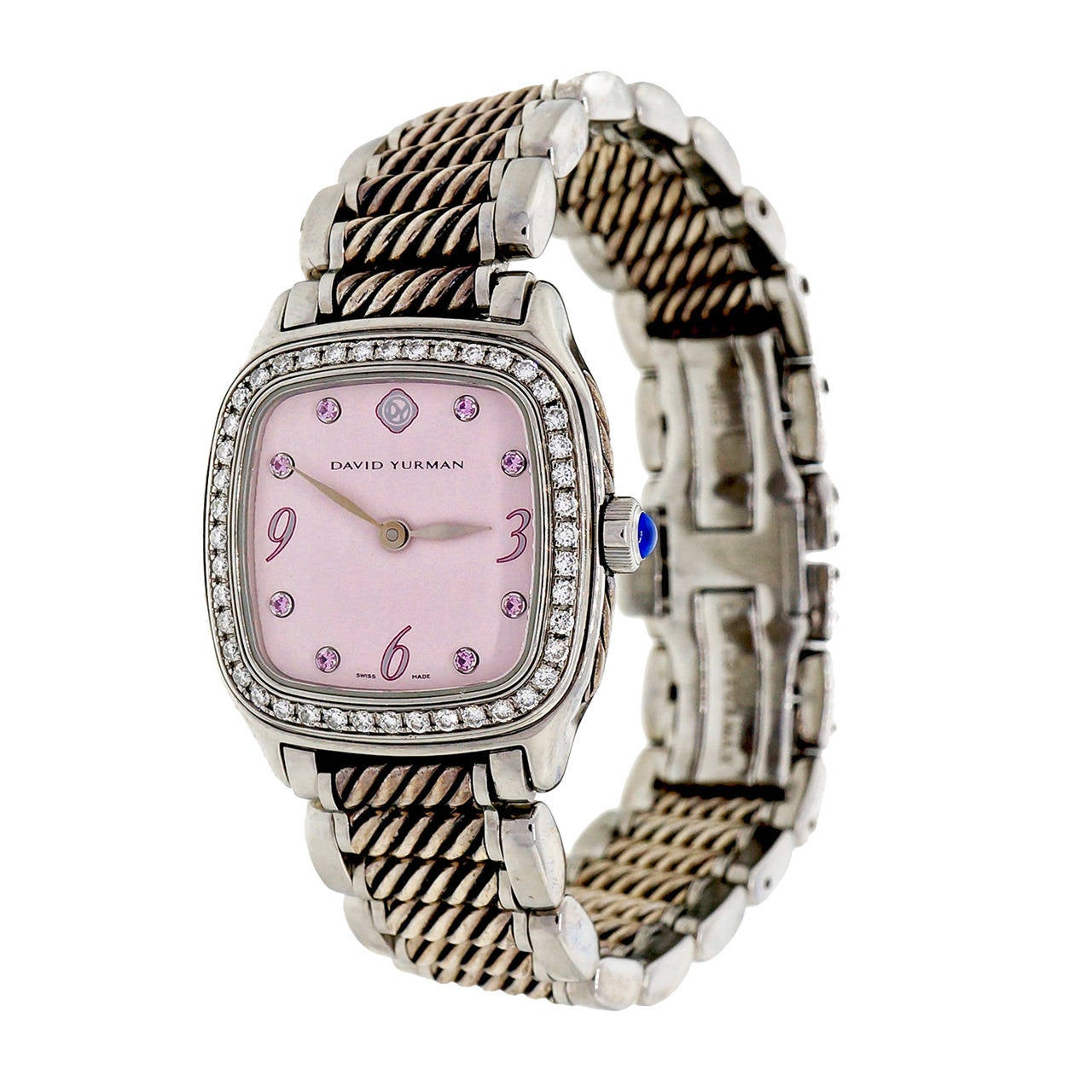 David Yurman Lady's Stainless Steel Diamond and sapphire. Thoroughbred Wristwatch, quartz movement  Stainless steel Bezel 45 full cut diamonds Dial: 8 pink Sapphire Length: 31mm Width: 26mm Case thickness: 7.41mm Bracelet width at case: