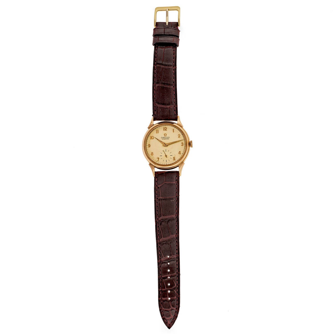 Omega 18k Rose Gold Wristwatch Retailed by Tiffany & Co circa 1960s  18k rose gold Length: 44mm Width: 35.5mm Strap width at case: 18mm Case thickness: 10mm Dial: Omega Tiffany & Co Movement: Omega Swiss 17 jewels 266 138883897  All of our