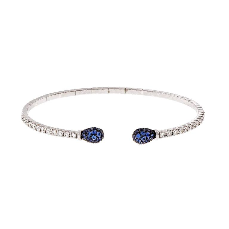Designer Spark 18k white gold cuff bangle bracelet with blue Sapphires and fine white diamonds.
