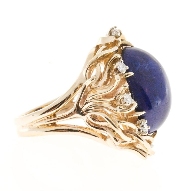 1950's open work solid 14k yellow gold ring with high grade full cut diamonds surrounding a bright well-polished rare certified violet blue Lapis with no enhancements. Top gem color.