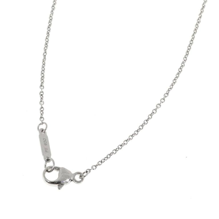 Tiffany & Co round diamond pendant solid Platinum approx. 1 inch across open work design.  81 round full cut diamonds, approx. total weight .82cts, F, VS 950 Platinum Tested: Platinum Stamped: PT 950  Stamped on pendant and chain Hallmark: