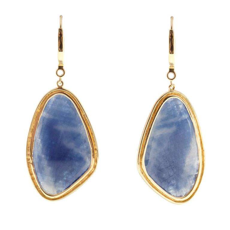 Designer JMP dangle earrings with Sapphire slices in dangle style surrounded by diamonds   2 custom cut Sapphires, approx. total weight 16.00cts, 31.43 x 17.81 x 4.37mm 144 round diamonds, approx. total weight .75cts, I, SI – I  18k yellow gold