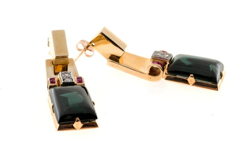 Ruby Diamond and Green Tourmaline set in a rose gold dangle earring.