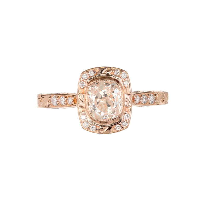 Peter Suchy scroll cushion bezel set simple halo diamond engagement ring. Scroll shoulders and sides. 18k rose gold setting which a wedding band can sit flush to the ring. The stone is from the late 1800's, old mine brilliant cut cushion shape with