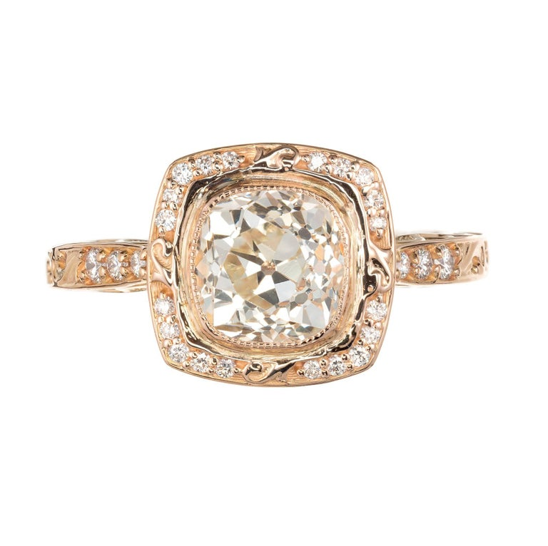 Peter Suchy  square scroll cushion bezel set, simple halo design engagement ring with scroll shoulders and sides. 18k rose gold setting with diamond accents. A wedding band can fit flush to the ring. Old mine brilliant cut squarish cushion cut