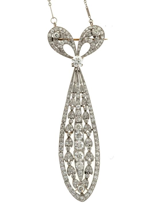 Women's Tiffany & Co. Diamond Platinum Bow Pin Pendant  For Sale