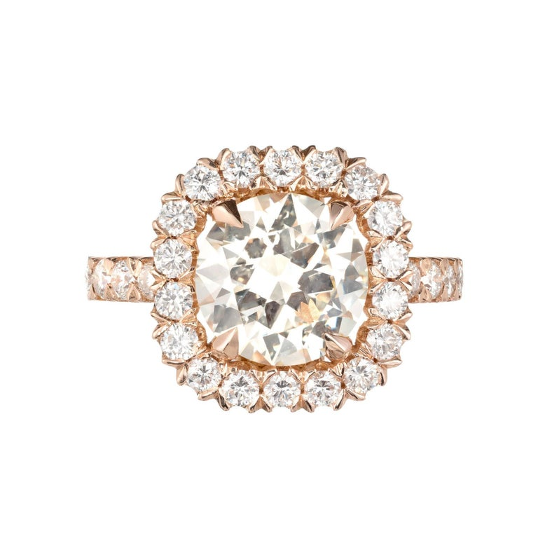 Peter Suchy Diamond Halo Rose Gold Engagement Ring. 2.43 round diamond with a halo of diamonds in an 18k rose gold setting with diamonds along the shank. GIA certified  1 round brilliant cut diamond, approx. total weight 2.43cts, S-T, VS1,
