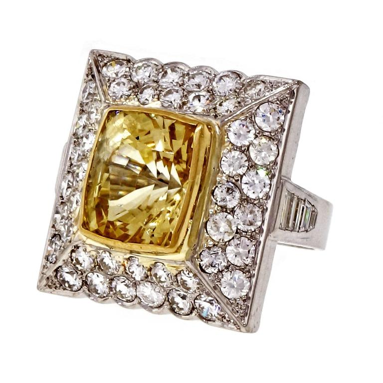 1950's French solid Platinum ring. Square top Pavé set with bright sparkly diamonds. Natural no heat GIA certified cushion cut yellow sapphire. Bright cutting and soft natural color.  1 cushion yellow Sapphire, approx. total weight 13.81cts, no