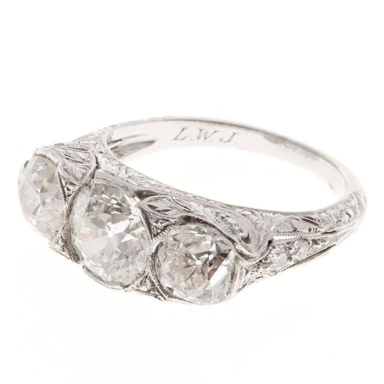 Edwardian Old Mine Diamond Platinum Three Stone Engagement Ring