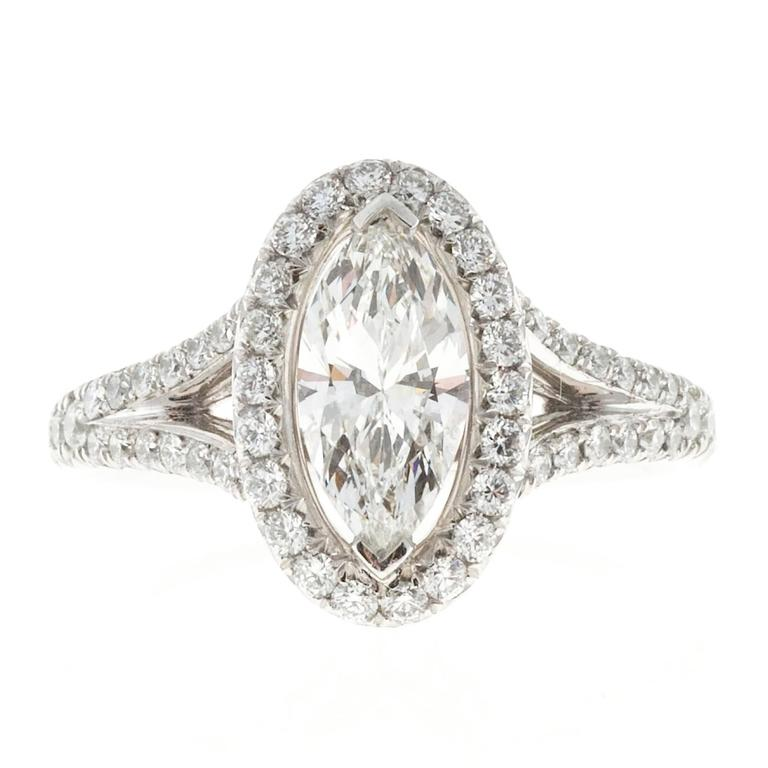 Pete Suchy Ideal cut Marquise diamond engagement ring 0.99ct in a custom design split platinum diamond shank with with an oval Halo of diamonds. GIA certified  1 Ideal Marquise diamond, approx. total weight .99cts, H, SI1, Depth: 61.3%  Table: 60%,