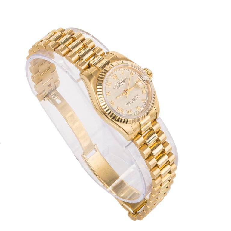 Rolex lady's 18k yellow gold Datejust wristwatch, Ref. 179178, circa 2002, cream-colored textured dial with gold Roman numerals. The dial has a pattern on it that is hard to photograph. the close up photo captures it accurately.   18k yellow gold