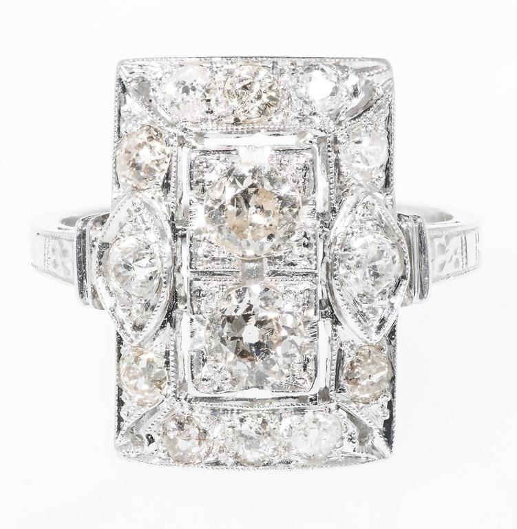Original Art Deco 1920 Platinum rectangular top ring with original old European cut diamonds.  2 old European cut diamonds, approx. total weight .34cts, H, SI 2 old European cut diamonds, approx. total weight .12cts, H, SI 10 old European cut