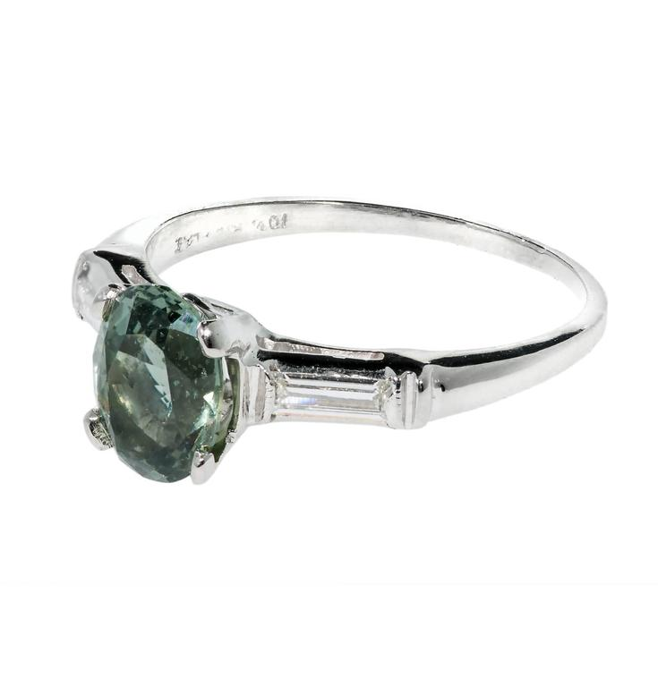 Rare original 1940 natural GIA certified no heat untreated green Sapphire engagement ring with a hint of blue. One of a kind unique color. Original 1940 Platinum ring with straight baguette accents.  1 oval bluish green Sapphire, approx. total