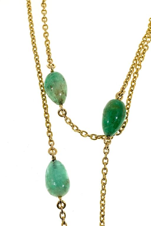 Natural Emerald circa 1860 Victorian long chain in handmade 15k yellow gold chain with 10 genuine Emerald beads approx. 50.00cts total. 58 inches long. Can be worn single, double or triple. Center section 12 inches of plain chain. 5 Emeralds each