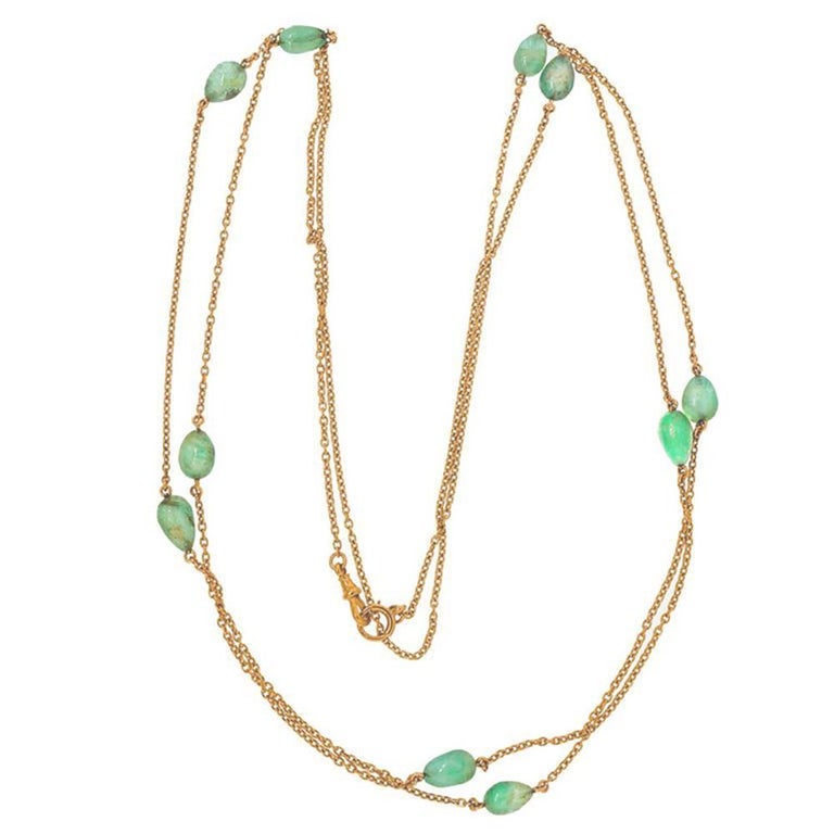 Natural pear shaped emerald necklace. Circa 1860s Victorian gold long chain in handmade 15k yellow gold chain with 10 genuine Emerald beads approx. 50.00cts total. 58 inches long. Can be worn single, double or triple. Center section 12 inches of