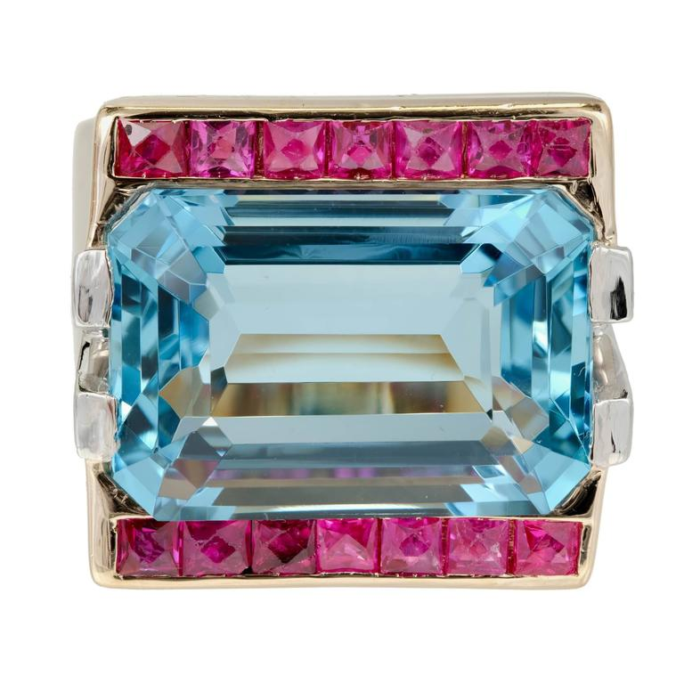 Retro Art Deco 1935 natural gem untreated Aqua with calibre cut Ruby borders and diamond accents in a 14k rose gold setting.   14k Pink gold 1 gem natural fine deep greenish blue Aqua, approx. total weight 15.83cts, VS, 18.3 x 13mm, natural, no heat